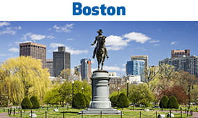 Boston, MA - monument with city buildings in background